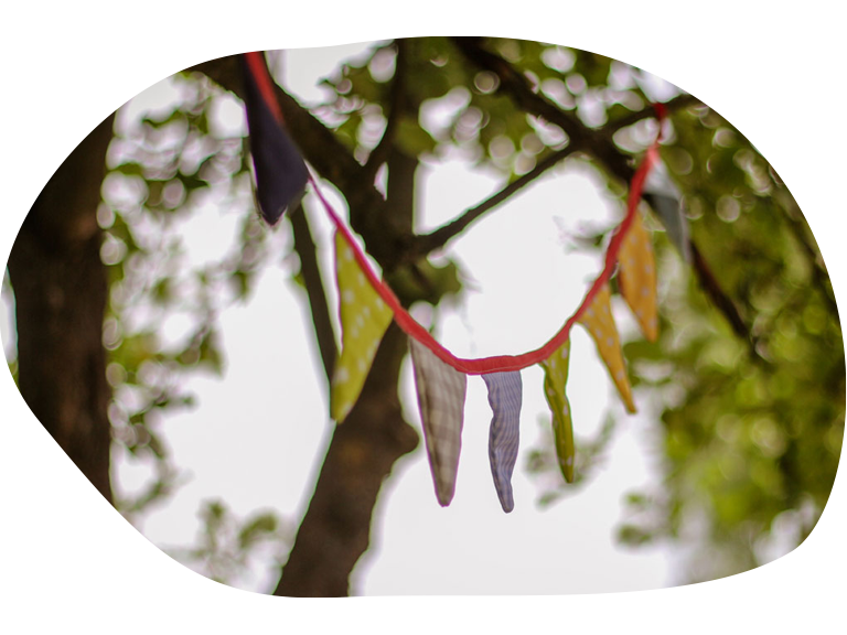 Kids Village (patterned bunting in a tree)