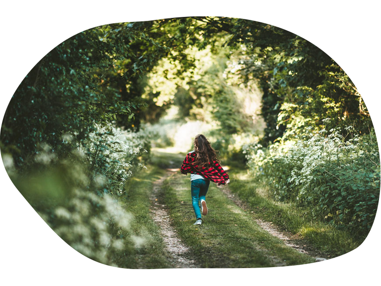 Go on a Kids Village Break (girl running through the woods)