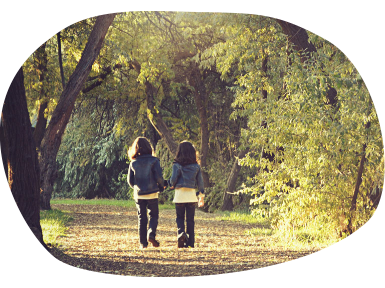 The Kids Village resources (two children walking through the woods)
