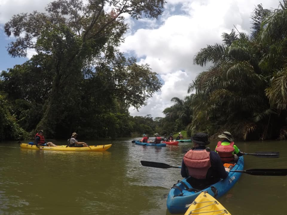 Costa Rica Kids Village (team in kayaks on a river)