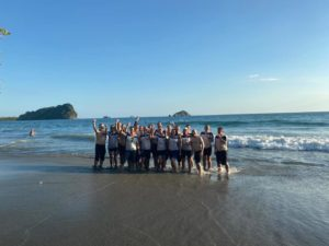 Costa Rica Challenge Kids Village (team standing in the sea)